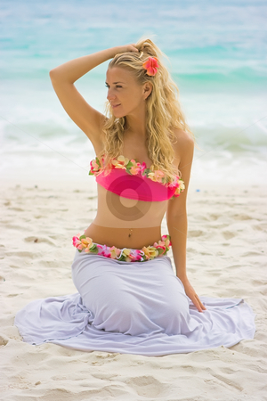 On the beach stock photo, Blonde girl in hawaii flowers sitting on the beach by Dmitry Rostovtsev