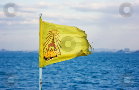 Royal Thailand flag stock photo, Yellow royal Thailand flag on the boat by Dmitry Rostovtsev