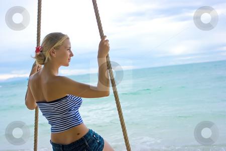 On rope swings stock photo, Blonde, rope swings, and the ocean by Dmitry Rostovtsev