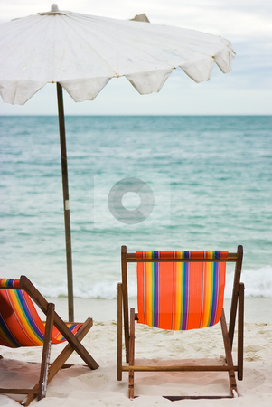 Two chairs and umbrella on the beach stock photo, Two chairs and umbrella standing on the sand beach by Dmitry Rostovtsev