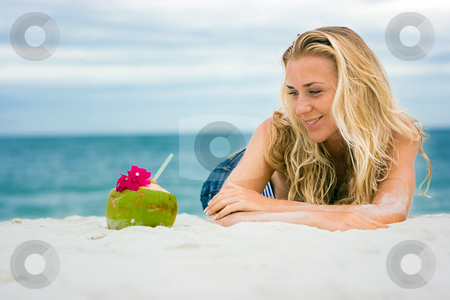 Sea, coconut and blonde stock photo, Beautiful blonde on the sea sand beach by Dmitry Rostovtsev