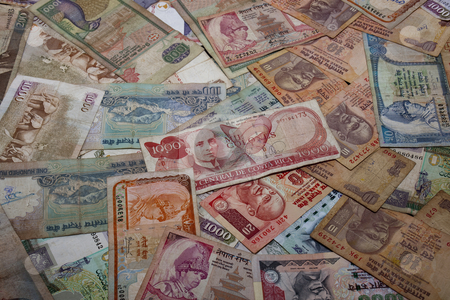 Travel money stock photo, An assortment of paper money from around the world by Mike Smith