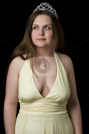 Prom queen looking up stock photo, Prom queen in yellow evening dress with v shape cleavage line, looking up by Yann Poirier