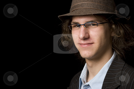 Teen with hat stock photo, Male teenager with a hat by Yann Poirier