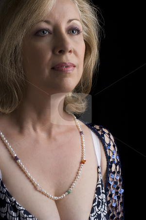 Portrait of a middle age women stock photo, Portrait of a women in her early fifties by Yann Poirier