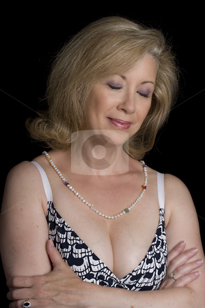 Pensive women stock photo, Women in her early fifties with her eyes close and pensive expression by Yann Poirier