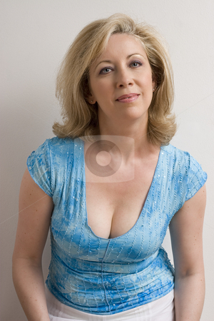 Portrait of a middle age women stock photo, Portrait of a women in her early fifties with a little smile by Yann Poirier
