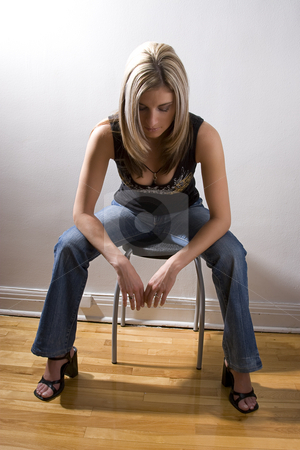 Taking a moment stock photo, Thirty something women dress sitting on a stool with her head down, taking a moment to relax by Yann Poirier