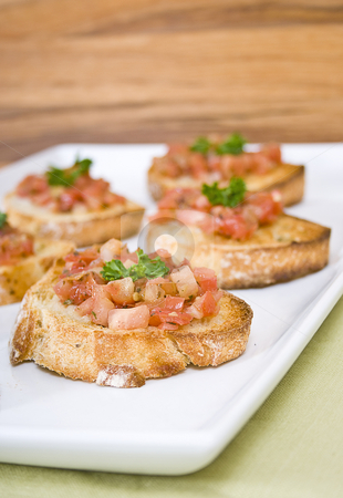 Italian bruschetta on a white serving plate stock photo, Italian bruschetta on a white serving plate by Vincent Demers