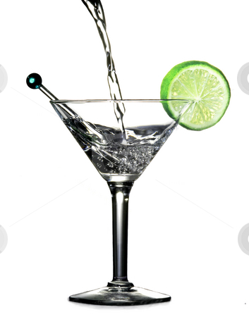 Pouring alcohol in a martini glass with slice of lime stock photo, Pouring alcohol in a martini glass with slice of lime by Vincent Demers
