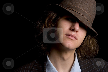 Hidding feature stock photo, Male teenager with a hat tipped over the eyes by Yann Poirier