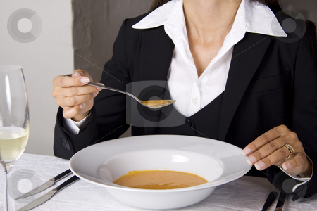 Business woman is having lunch stock photo, Business woman is having lunch at a frensh gourmet restaurant. by Daniel Kafer