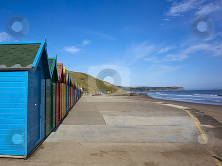 Colourful beach huts 2 stock photo, A row of colourful beach huts on the east coast of england by Mike Smith