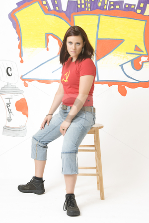 Girl annoyed stock photo, Teen girl sitting on a stool looking annoyed by Yann Poirier