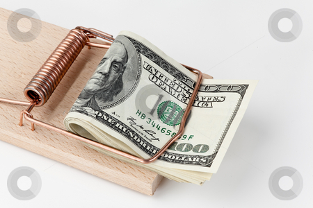 U.S. dollars in bank notes in mousetrap stock photo, Many U.S. dollar banknotes in mousetrap by Erwin Johann Wodicka