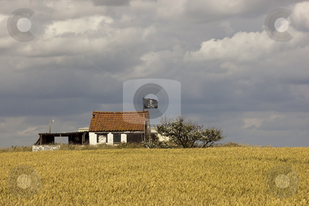 Pirates hideaway 2 stock photo, A pirates hideaway with wheatfield under a dramatic sky by Mike Smith