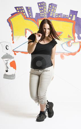 Cross stepping stock photo, Late twenties break dancing girl cross stepping by Yann Poirier