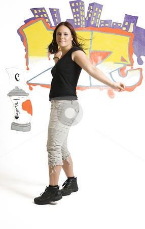 Open step stock photo, Late twenties break dancing girl doing an open step by Yann Poirier