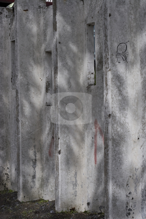 Concrete urban wall stock photo, Concrete wall in montreal, seen throught the shadows of leaves, with barely any graffiti by Yann Poirier