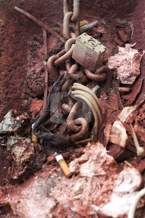 Chain and lock stock photo, Old rusted chain and pad lock with garbage by Yann Poirier