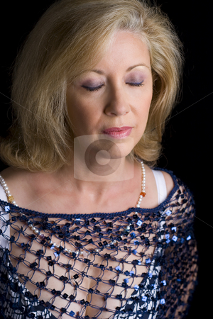 Eyes shut stock photo, Portrait of a women in her fifties with her eyes closes by Yann Poirier