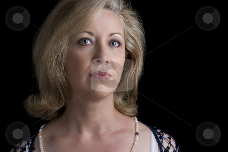 Women in her fifties stock photo, Portrait of a women in her fifties by Yann Poirier