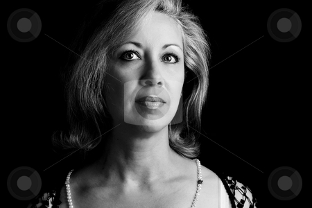 Women in her fifties in black and white stock photo, Portrait of a women in her fifties in black and white by Yann Poirier