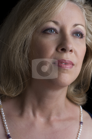 Sadden stock photo, Women in her fifties with a sad expression in her eyes by Yann Poirier