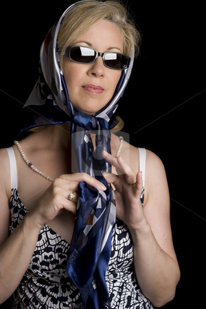 Scarf and Glasses stock photo, Women in her early fifties with classic Audrey Hepburn, scarf and glasses look by Yann Poirier