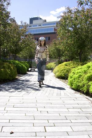 Walking in a park stock photo, Teen girl walking in a park by Yann Poirier