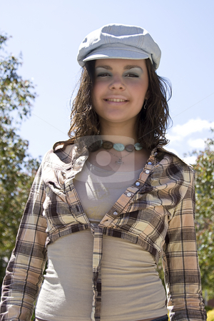 Happy to be outside stock photo, Teen girl with great big smile enjoying the outdoor by Yann Poirier
