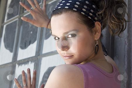 Pushing a window stock photo, Teen girl pushing on a window by Yann Poirier