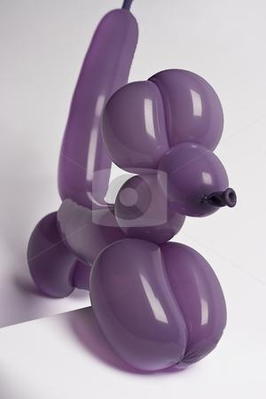 Purple balloon dog stock photo, Purple balloon dog climbing a pedestal by Yann Poirier