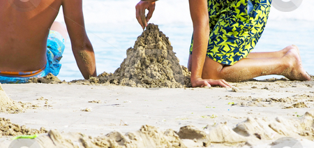 Happy summer stock photo, Two boys having fun with sand at the beach by Desislava Dimitrova
