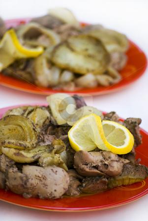Chicken liver stock photo, Chicken liver with lemon and onion by Desislava Dimitrova