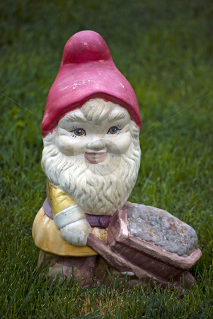 Garden decorative statue stock photo, Dwarf garden decorative statue on green grass by Desislava Dimitrova