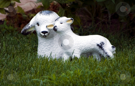Garden decorative statue stock photo, Little lamb and sheep garden decorative statue on green grass by Desislava Dimitrova