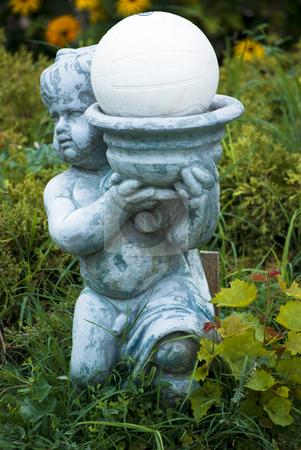 Garden decorative statue stock photo, Boy garden decorative statue on green grass by Desislava Dimitrova