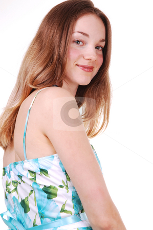 Young lady in blue white dress. stock photo, Beautiful young woman in a blue, green and white dress smiling over  her shoulder and looking in the camera, on white background. by Horst Petzold