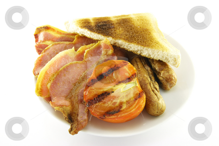 Breakfast and Toast on a White Plate stock photo, Slices of crispy pork bacon with half a grilled tomato, two thin pork sausages and a slice of lightly toasted bread on a white round plate with a white background by Keith Wilson