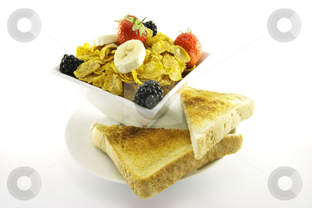 Cornflakes and Fruit with Toast stock photo, Cornflakes with strawberries, blackberries and banana in a square white bowl with toast on a plate with a white background by Keith Wilson