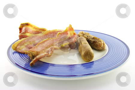Bacon and Sausage stock photo, Slices of crispy pork bacon and two thin pork sausages on a blue round plate with a white background by Keith Wilson