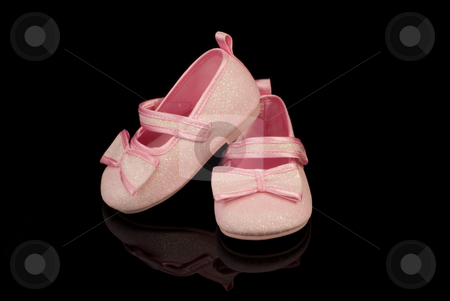 Pink child boots stock photo, Pink child boots on black reflective mirror by Sylwia Marzjan
