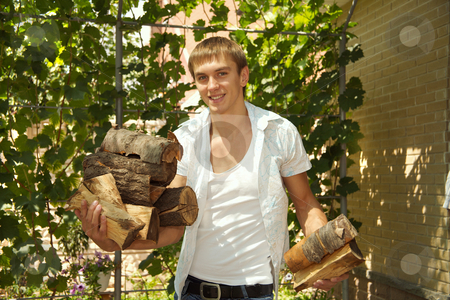 Fire wood for a barbecue stock photo, Preparation of fire wood for a barbecue is carried out in the summer by Sergey Goruppa