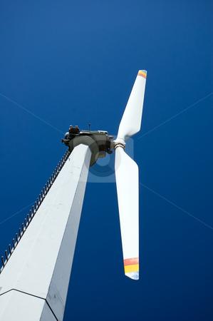 Mountain wind turbine stock photo, An high mountain wind turbine with blue sky background by Roberto Marinello