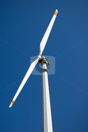 Mountain wind turbine stock photo, An high mountain wind turbine with blue sky background by Roberto Marinello