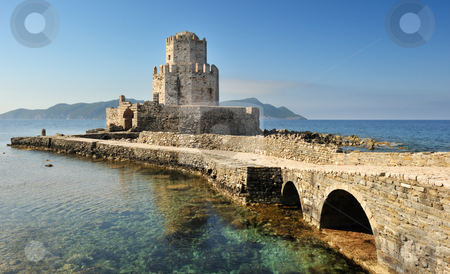 The watchtower of the medieval castle of Methoni, southern Greec stock photo, Picture of the watchtower from the medieval castle at Methoni, southern Greece, as it extends into the sea. by Andreas Karelias