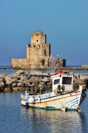 Fishing boat in Methoni stock photo, Picture of a fishing boat in front of the Methoni castle in southern Greece. by Andreas Karelias