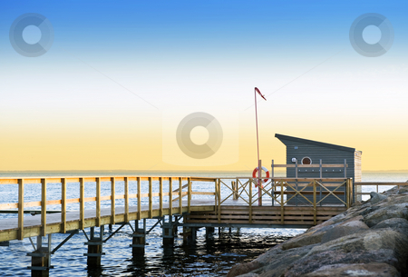 Lifeguard station stock photo, Lifeguard station and pier on a tranquil evening on the south coast of Sweden, looking out towards Danemark by Corepics VOF