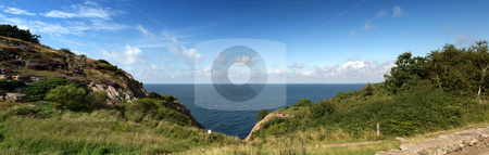 Ocean view stock photo, Panoramic ocean view wedged in between two hills and a steep cliff by Corepics VOF